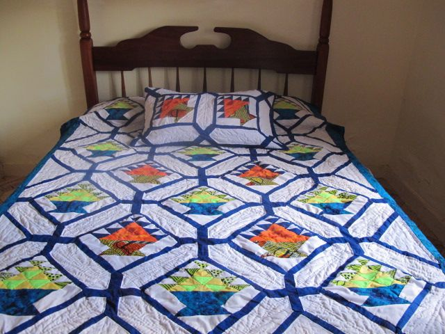 """Our beautiful bedsize basket quilt. Measures 68"""" x 85"""" and comes with 1 matching pillow sham. On the photo below you will notice the amount of hand quilting done on this quilt. The same pattern is used for the border. The price for this quilt is $125 plus shipping."""