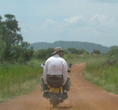 Todd enjoying his boda-boda ride to the village.