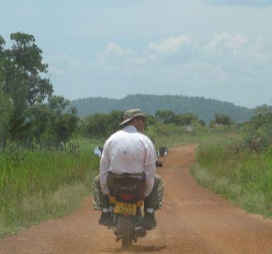 Todd enjoying his boda-boda ride to the village.